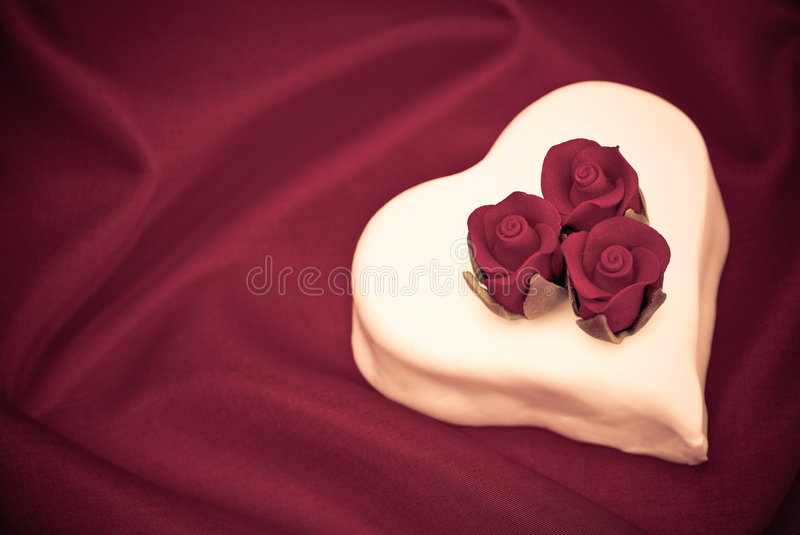 Valentines Day Heart Cake. Heart shape Valentines day cake in purple stock image