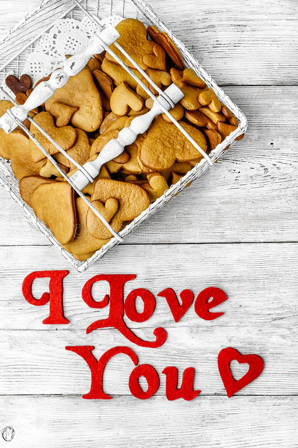 Valentines Day heart shaped cookies. Wicker basket with cookies and the inscription in love royalty free stock photos