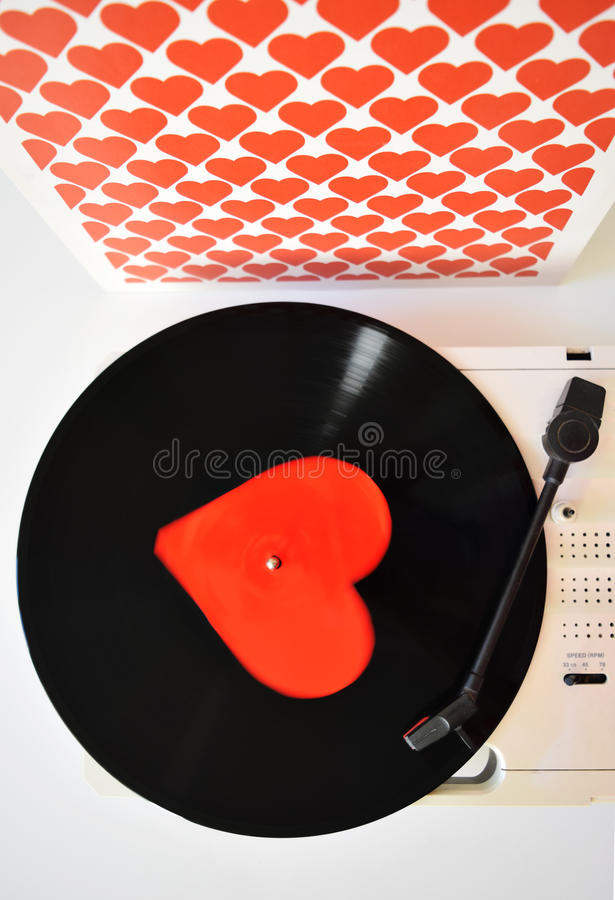 Valentines day with heart and vinyl record on the white background. Composition Valentine's Day with a vinyl record and heart and white background with hearts royalty free stock photo