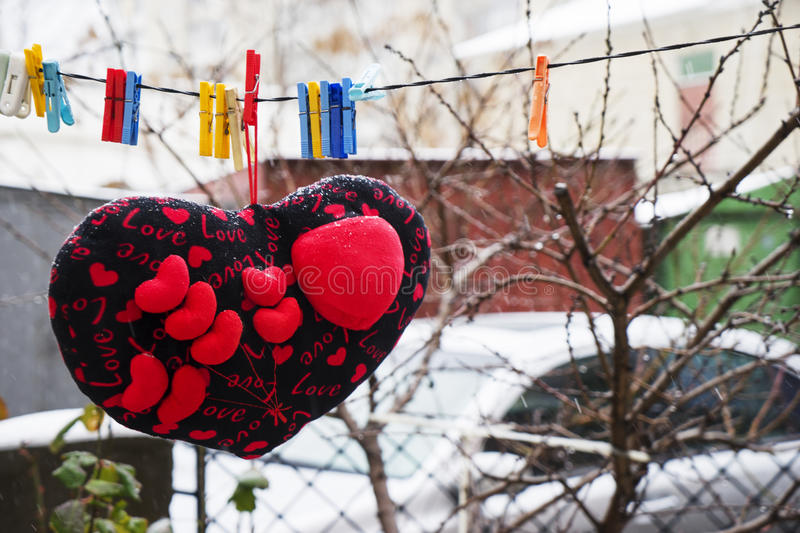Valentines day. hearts soft pads hanging on a rope. In the yard stock photos
