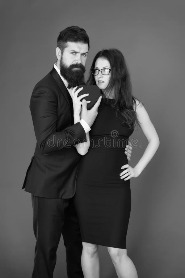 Valentines day holiday. Do not play with my heart. Man with beard and woman happy celebrate anniversary. Couple in love royalty free stock photos