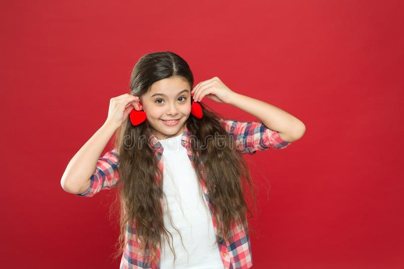 Valentines day. I give you my heart. Small girl with cute look. Happy child with red decorative heart. happy little girl royalty free stock images