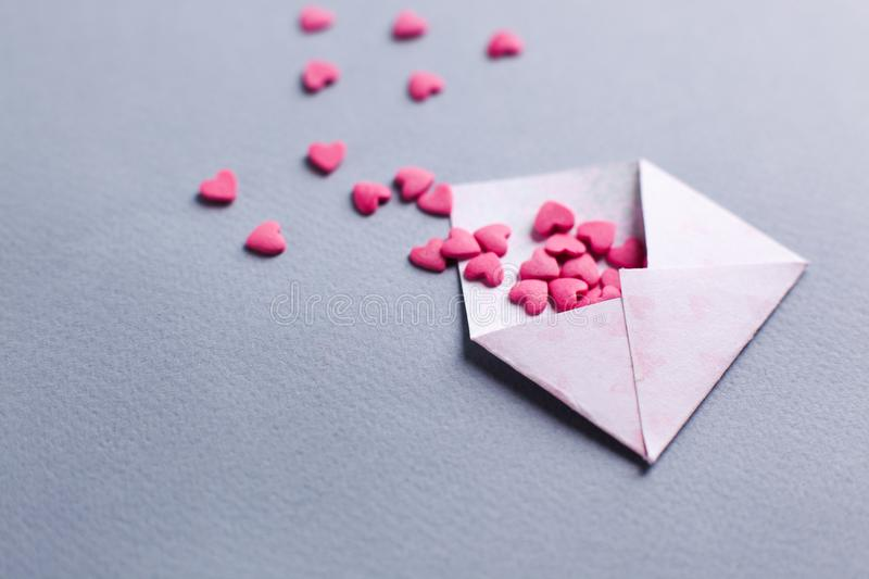 Valentines day love letter. opened envelope and many felt pink hearts. Empty copy space. royalty free stock photography