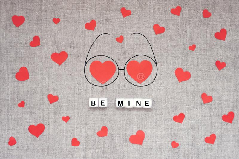 Valentines Day mockup, greeting card with many red hearts, two big heart in doodle eyeglasses and text BE MINE on linen fabric. Background. Valentine Day, love stock image