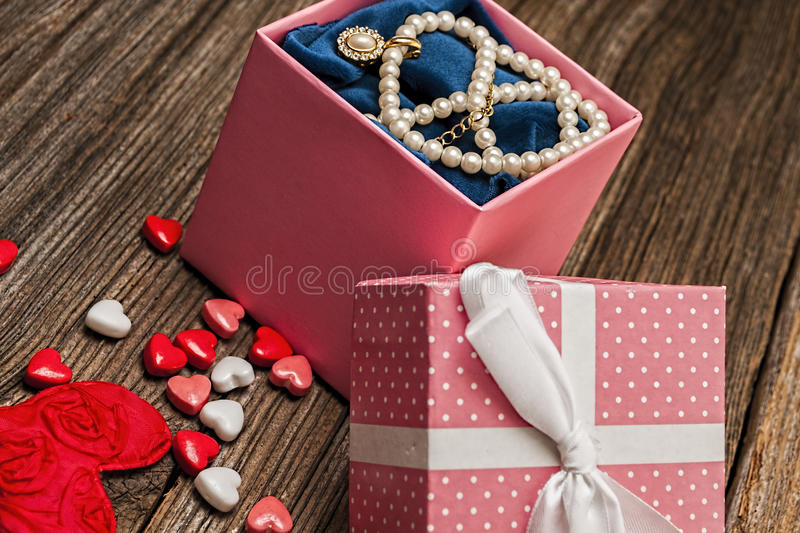 Valentines day pearl,diamond,necklase,gift. A Valentines day pearl,diamond,necklase,gift on rustic barnwood table royalty free stock photography