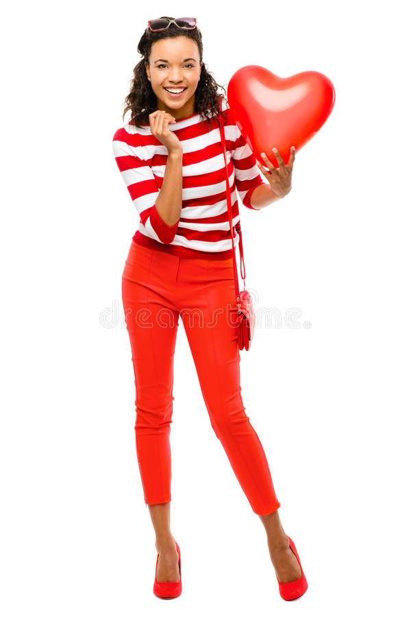 Valentines day portrait of Pretty Mixed race woman holding red h. Valentines day portrait of Pretty Mixed race girl holding red heart balloon royalty free stock photo