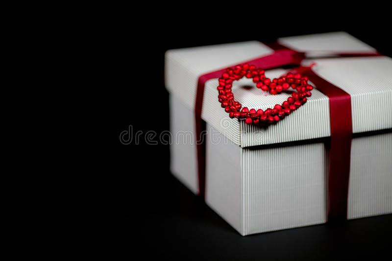 Valentines day present in romantic gift wrapped box with love he royalty free stock photo