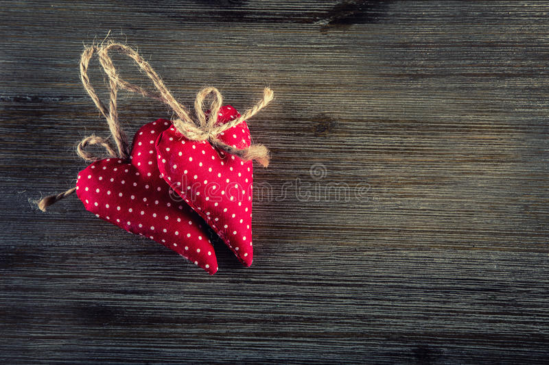 Valentines day. Red cloth handmade hearts on wooden background royalty free stock image