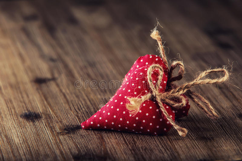 Valentines day. Red cloth handmade hearts on wooden background stock images