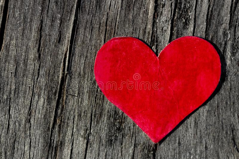 Valentines day red heart on old wood with copy space stock photo