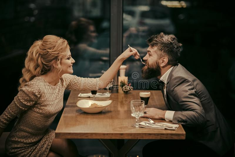 Valentines day with woman and bearded man. Date of family couple in romantic relations, love. Couple in love at the stock image