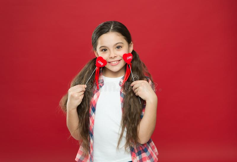 Valentines day. Small girl with cute look. happy little girl. Love and family. Childhood happiness. February holiday stock photography