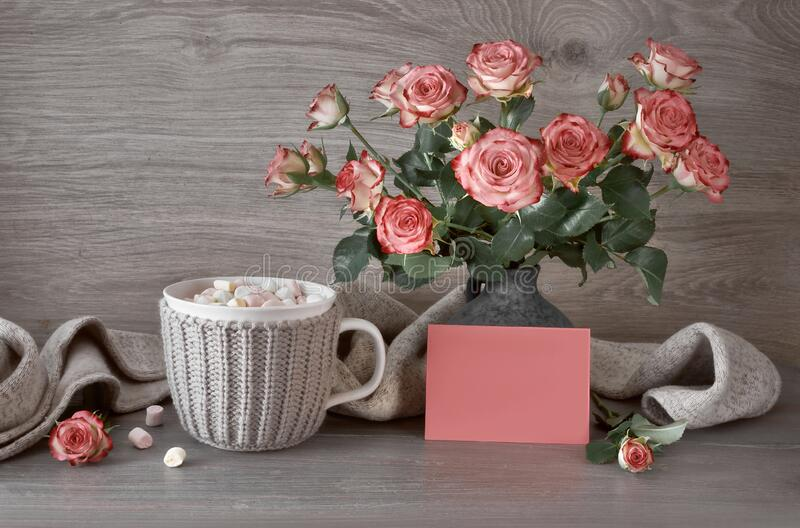 Valentines day still life with cup of hot chocolate with marshmallows, pink roses and greeting card with text. Valentines day still life with cup of hot stock photo