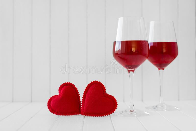 Valentines Day still life with hearts and glasses of wine over white background stock photo
