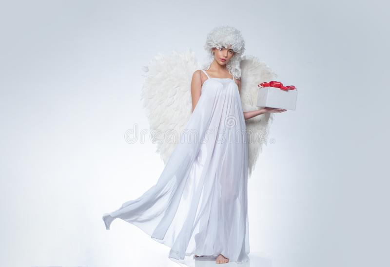Valentines Day symbol. Angel woman with wings . Art photo of a Angelic beautiful woman. Valentines Day symbol. Angel woman with wings . Art photo of a Angelic stock photo