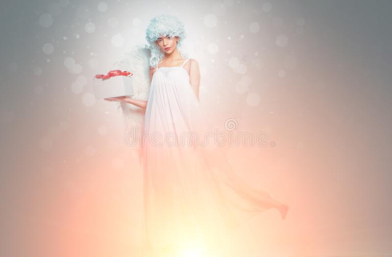 Valentines Day symbol. Angel woman with wings . Art photo of a Angelic beautiful woman. stock image