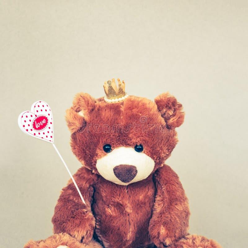 Valentines Day Teddy bear holding heart. Retro romantic style. Unusual creative greeting card stock photos