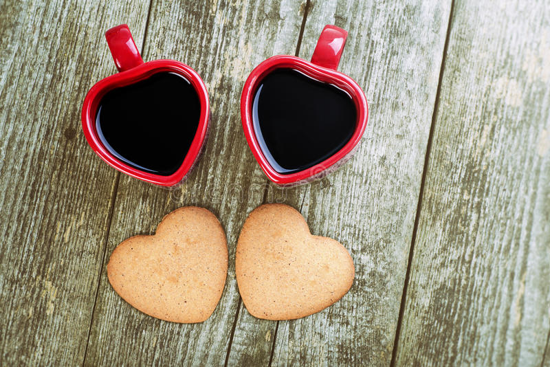 Valentines Day Top View Composition. Coffee Cups and Hearts. Valentines Day Composition. White Heart Between Boards aValentines Day Heart Shaped Cookies And Red stock photos
