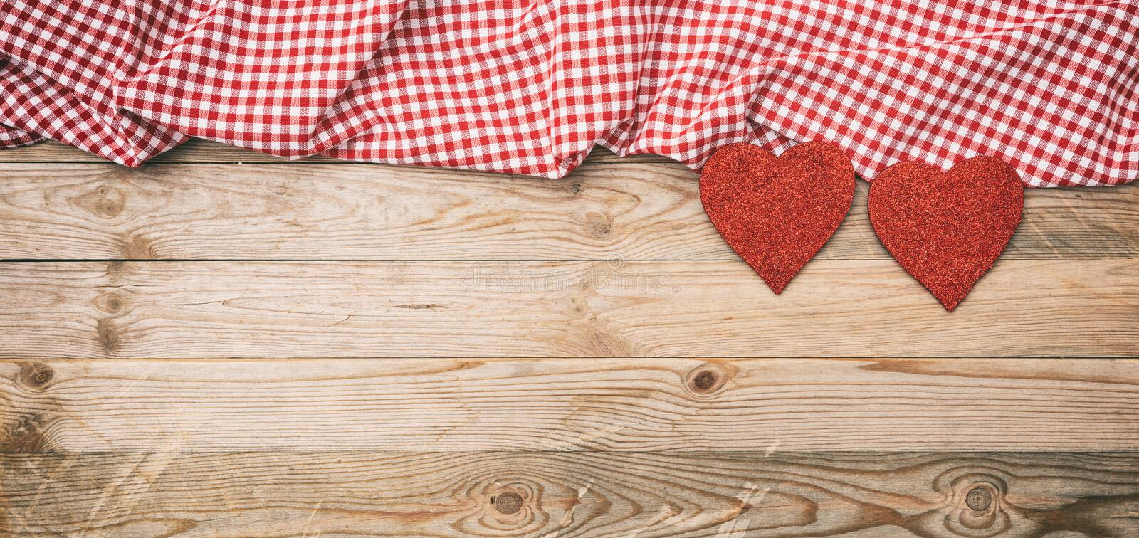 Valentines day. Top view of red fabric hearts, wooden background stock image