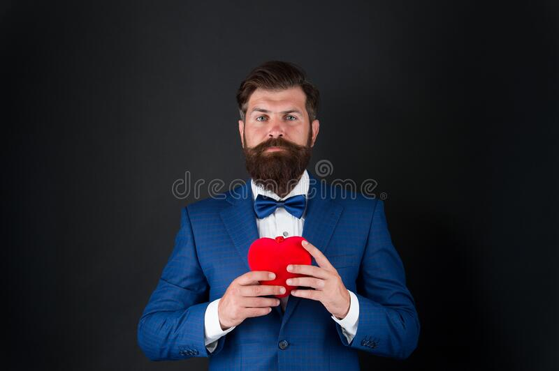 Valentines day. Well groomed handsome bearded man wear tuxedo. Romance and dating. Gentleman romantic soul. Man hold stock images
