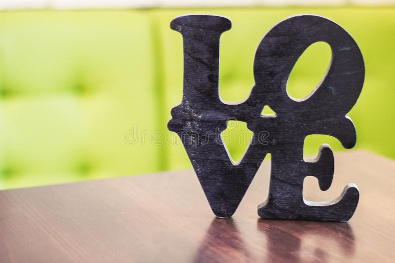 Word love wood table stock photos