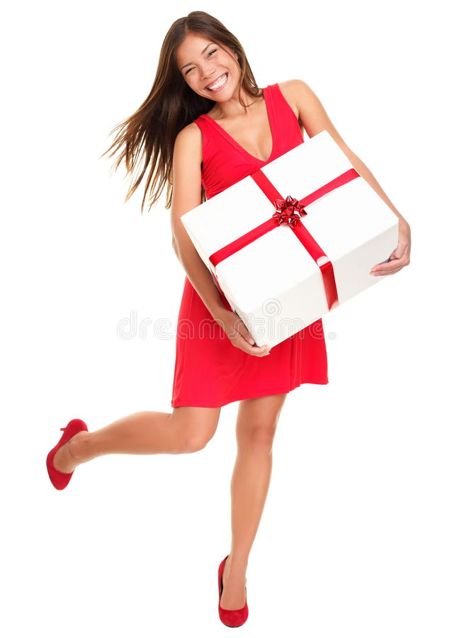 Valentines gift woman on white background. Valentines woman playful, joyful and excited standing isolated in full length on white background. Asian Chinese / stock photography