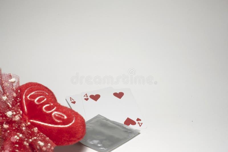 Valentines& x27 ; jour de s, numéro quatorze numéros de carte, préservatif empêcher concept d'amour de sexe sûr de valentines de  photographie stock libre de droits