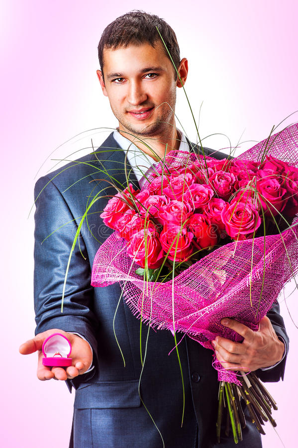 Valentines Man with flowers royalty free stock photography