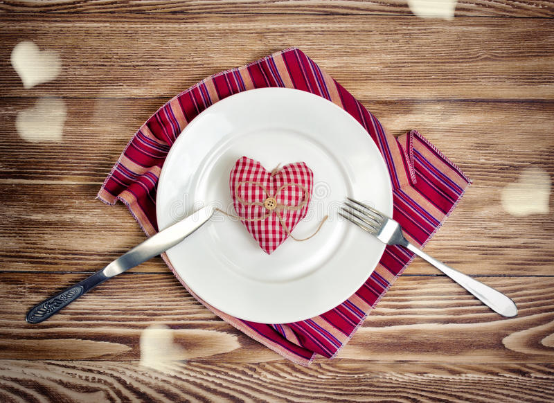 Valentines romantic dinner concept. Holiday meal served heart sh royalty free stock photo