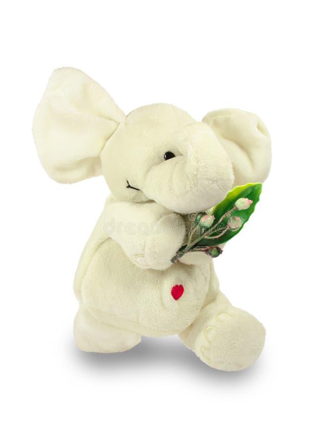 Valentins dag, en röd hjärta, en vit flott elefant, bär en grön filial royaltyfri fotografi