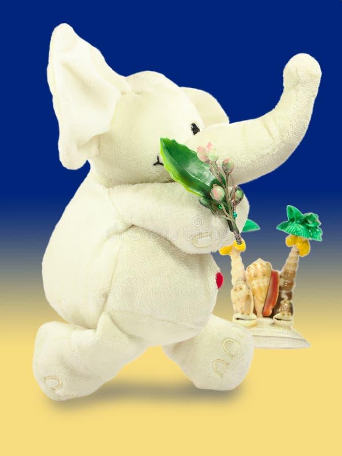 Valentins dag, röd hjärta, den vita flotta elefanten, bär en grön filial, gömma i handflatan ön, lutningpåfyllning royaltyfri bild