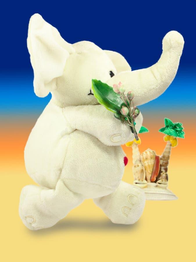 Valentins dag, röd hjärta, den vita flotta elefanten, uthärdar en grön filial, gömma i handflatan ön, tre-färg lutningpåfyllning royaltyfria foton