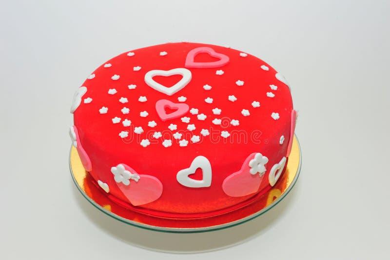 Valentinsgrußherz- und -blumenkuchen lizenzfreie stockfotografie