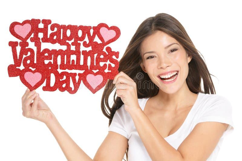 Valentinsgrußtag - Frau, die Zeichen zeigt stockbild