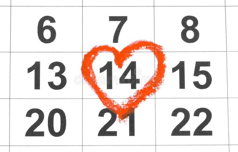 Valentinsgrußtag und Feiertagskonzept - Kalenderblatt mit dem am 14. Februar Datum markiert durch rote Herzform Abschluss oben lizenzfreie stockbilder