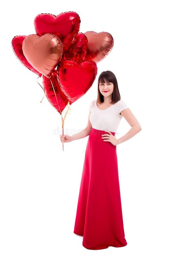 Valentinstag- oder Geburtstagskonzept - Ganzaufnahme der Frau mit den roten Ballonen lokalisiert auf Weiß stockbild