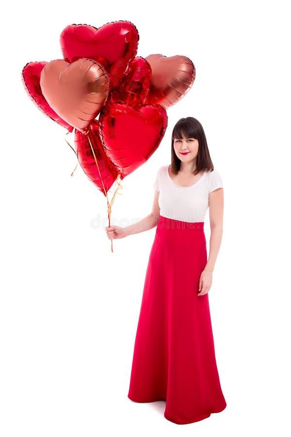Valentinstag- oder Geburtstagskonzept - glückliche Frau mit den roten Ballonen lokalisiert auf Weiß stockbild