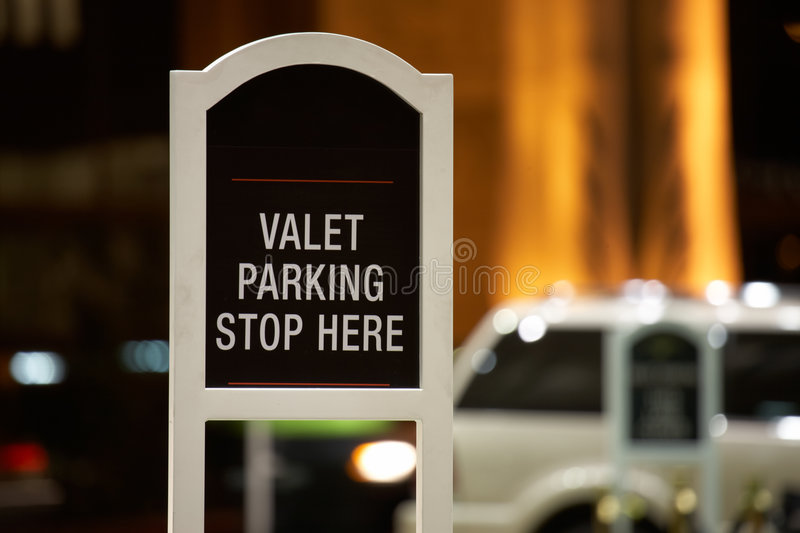 Valet parking - stop here sign royalty free stock photo