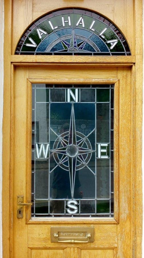 Valhalla compass window front door royalty free stock photo