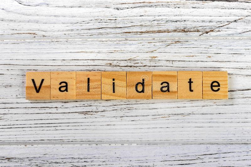 VALIDATE word made with wooden blocks concept.  royalty free stock images