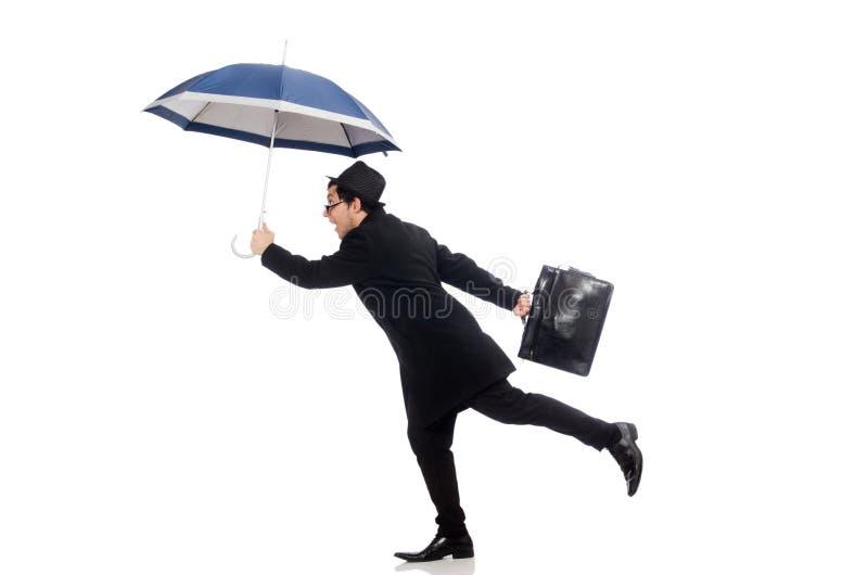Valigia ed ombrello della tenuta del giovane isolati fotografia stock
