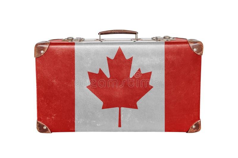 Valise de vintage avec le drapeau de Canadan photos stock
