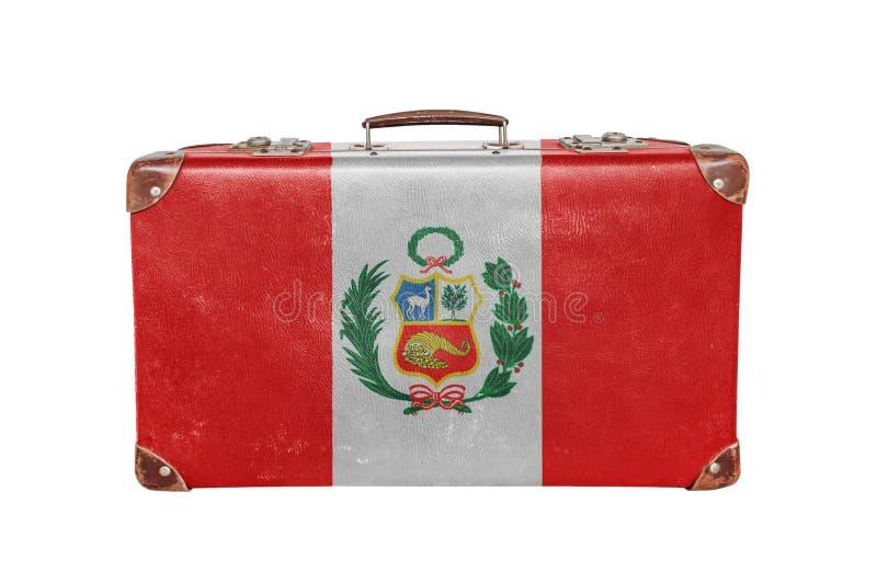 Valise de vintage avec le drapeau du Pérou photos stock