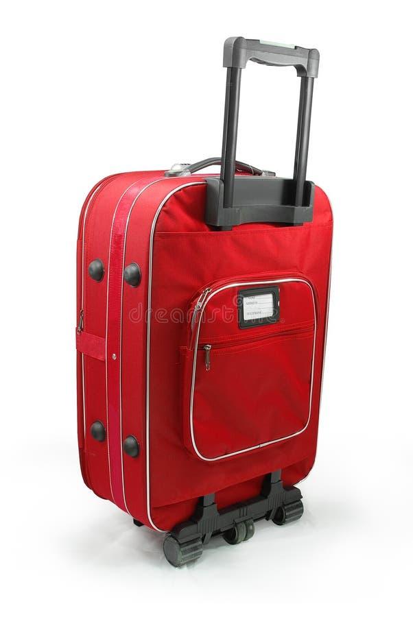 Valises rouges de course photo stock