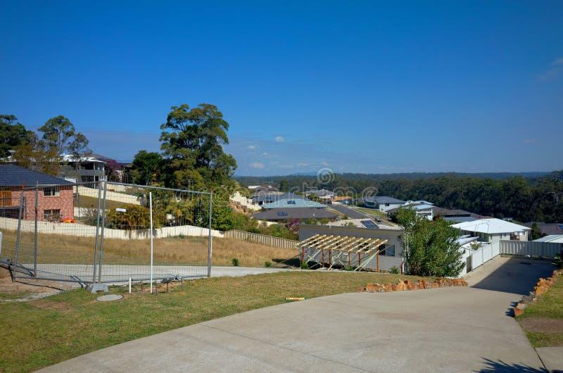 Valla-Strand-Australien-Stadtvorort mit Wohnhäusern lizenzfreie stockbilder