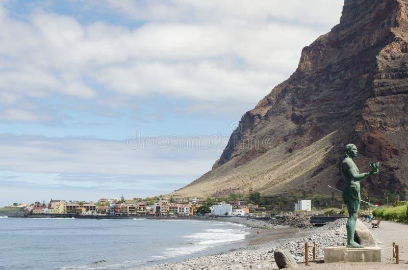 VALLE GRAN REY, LA GOMERA, SPAIN - MARCH 19, 2017: La Playa beach in La Puntilla with the statue of Hautacuperche. In the foreground stock photos
