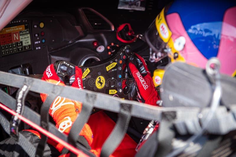 Vallelunga, Italy september 15 2019. Ferrari racing car steering wheel with logo royalty free stock photos