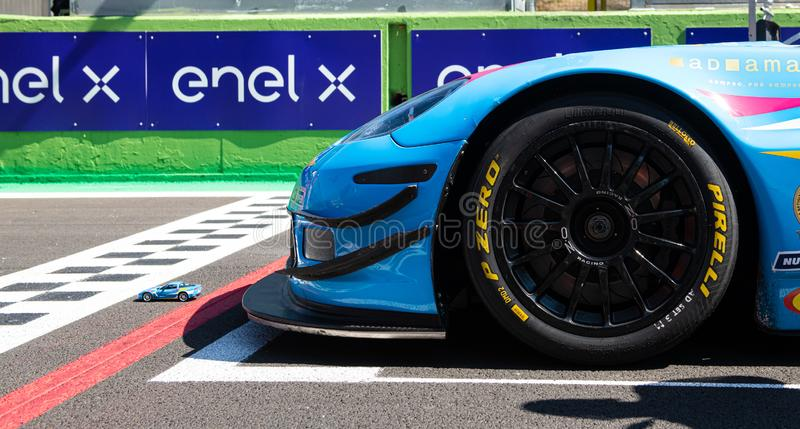 Vallelunga, Italy september 14 2019, Racing car good luck charm scale model in front of real car stock photography
