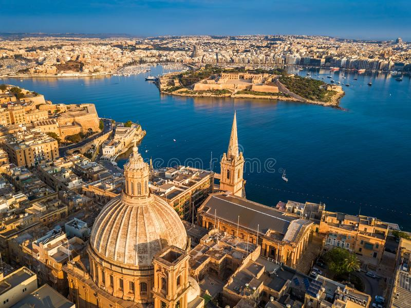 Valletta, Malta - Aerial view of Our Lady of Mount Carmel church, St.Paul`s Cathedral. And Manoel Island at sunrise stock image