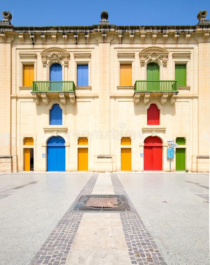 Colorful building in maltese village. Valletta, Malta - April 24, 2015: baroque facade with colorful doors in Valletta, Malta. Building in Valletta, Malta royalty free stock photo
